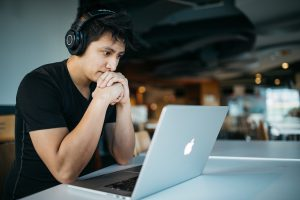 Man at computer with headphones