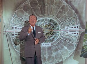 Walt Disney in front of a map of the Florida Project which became Walt Disney World.